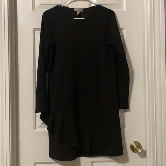 Black dress with ruffle design on bottom